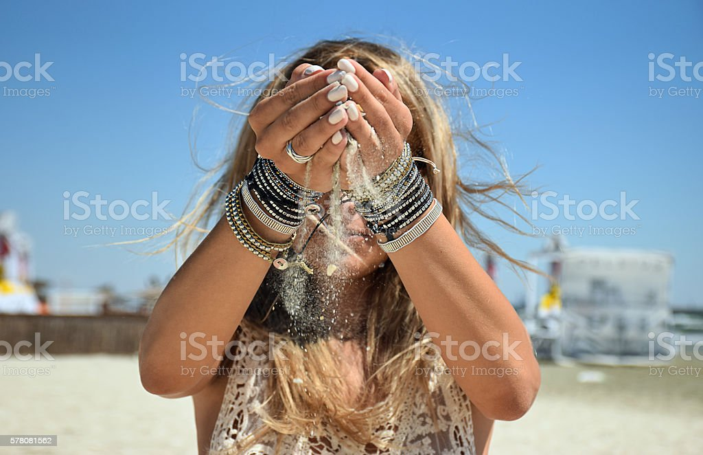 Sand in hands stock photo