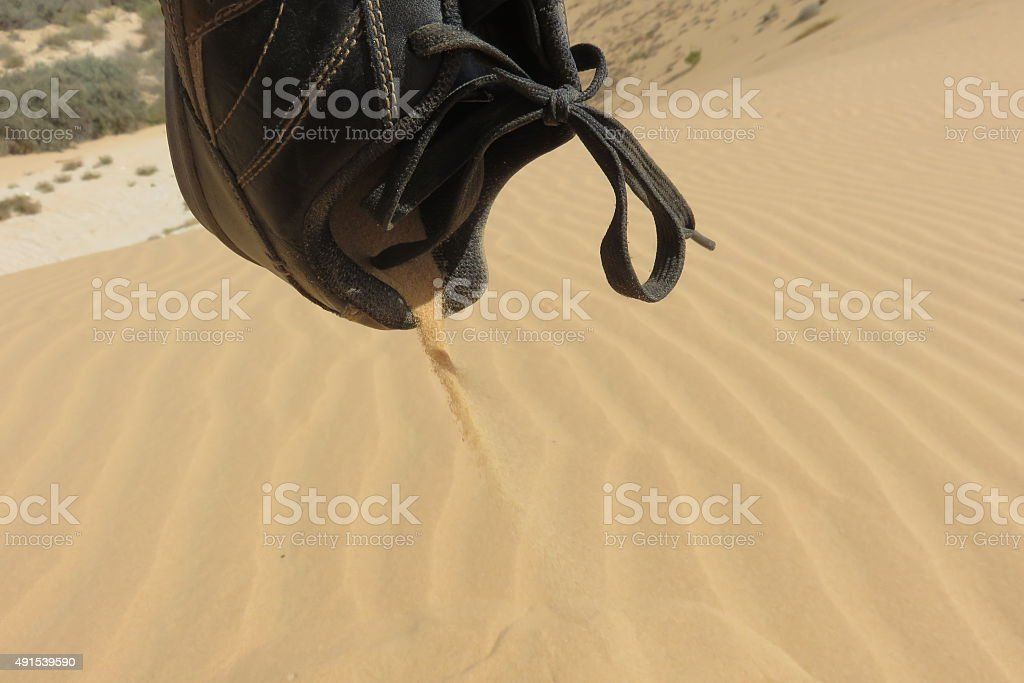 Sand in the shoe stock photo