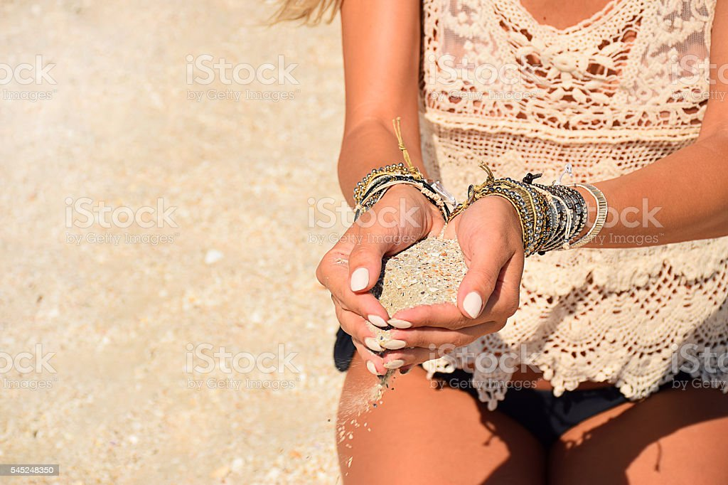 sand in woman hands stock photo