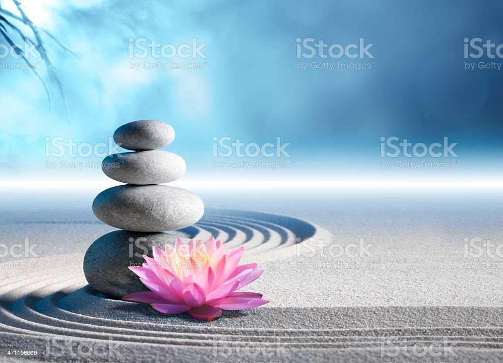 sand, lily and stones in zen garden - spa background stock photo