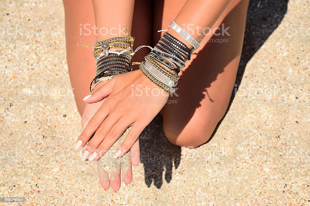sand on hands stock photo