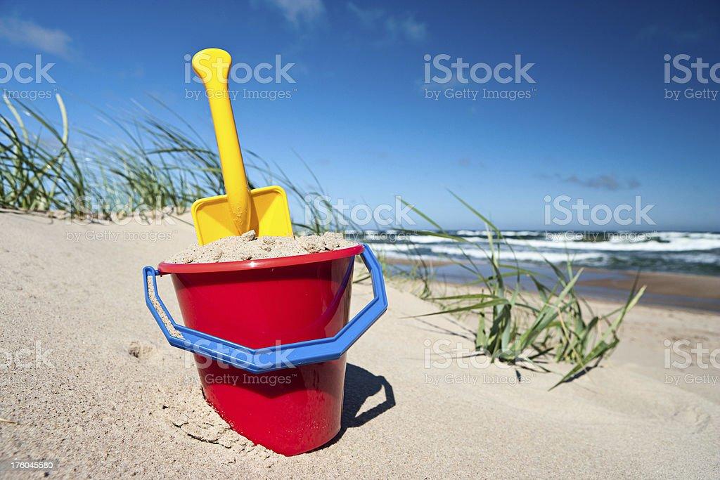 Sand pail and shovel stock photo