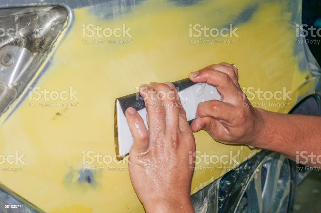 Sand paper hand for car body work auto repair paint stock photo