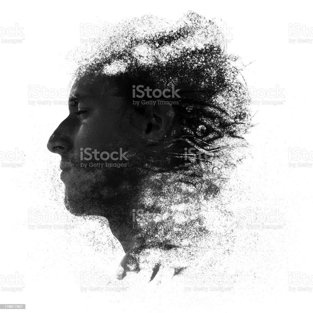 Sand particles forming human face stock photo