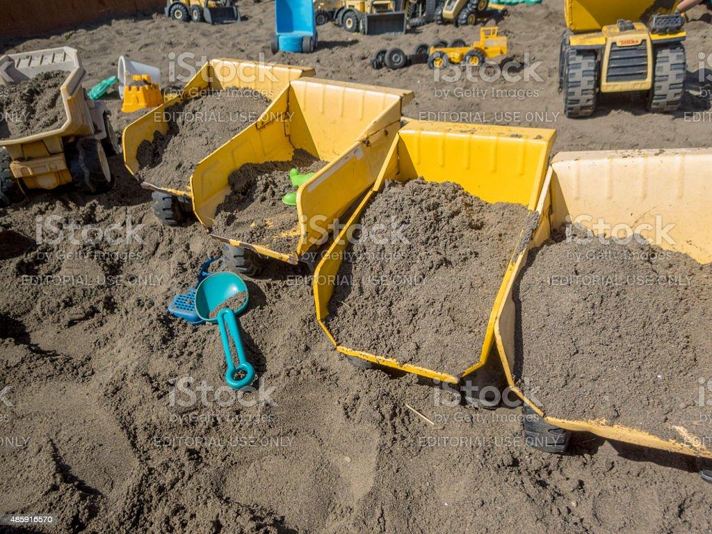 Sand Play Area Yellow TONKA Dump Truck Toy Shovel stock photo