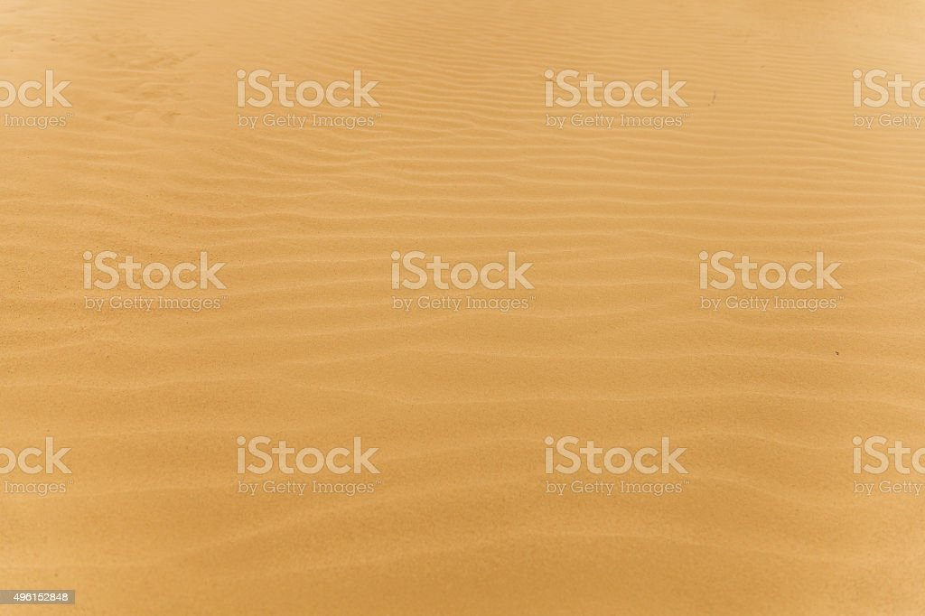 sand rippled by the wind in a desert stock photo