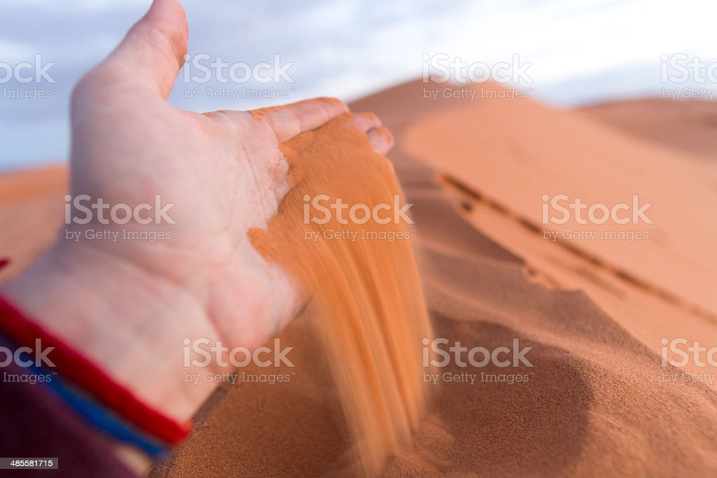 sand running through fingers royalty-free stock photo