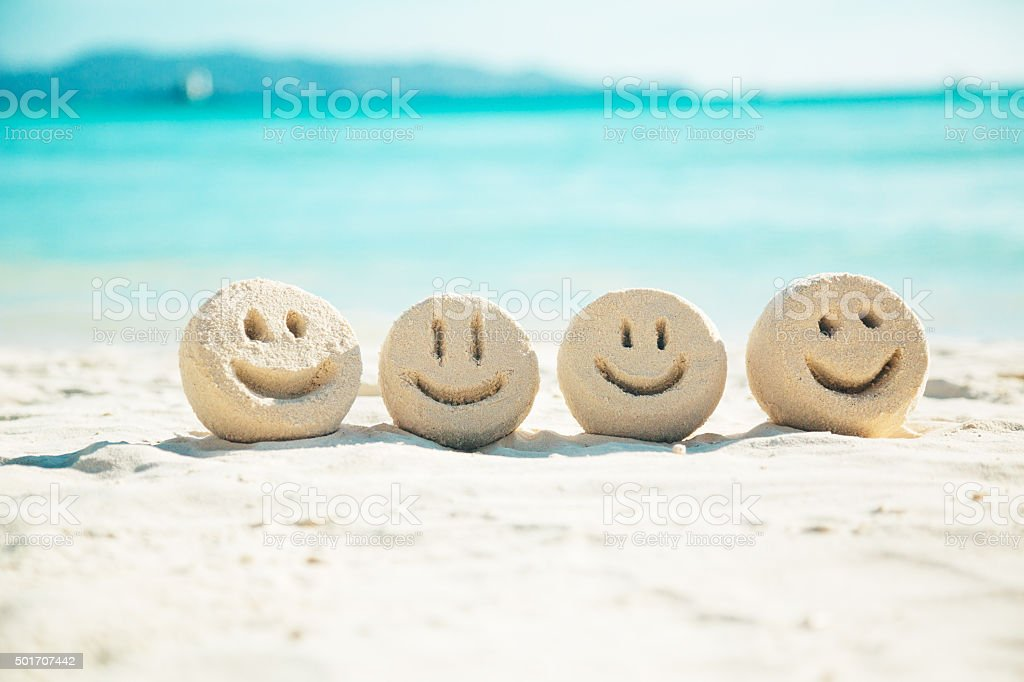 Sand smileys stock photo