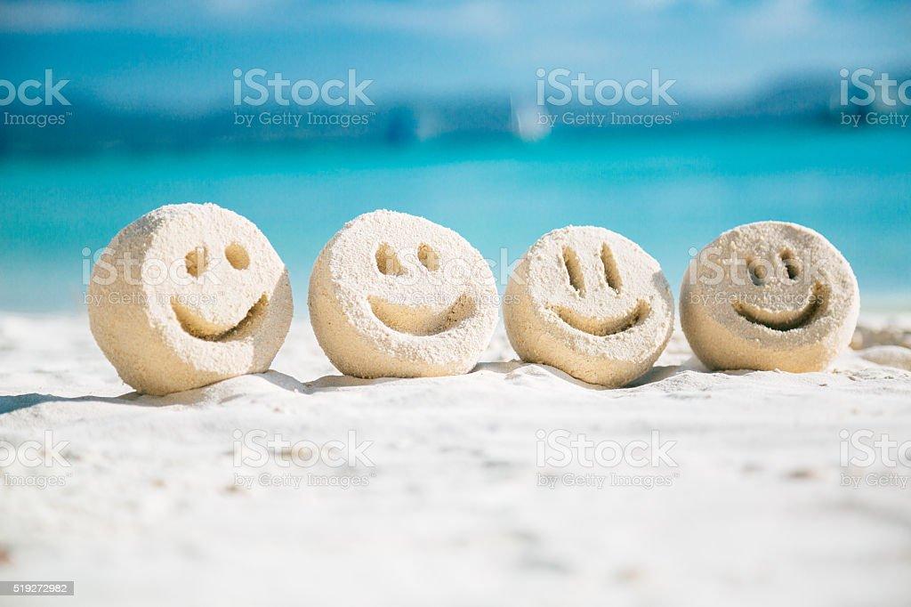 Sand smileys stock photo