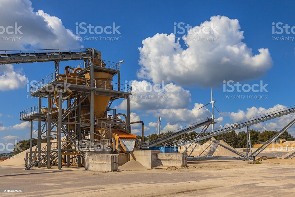Sand sorting installation under blue clouded sky stock photo