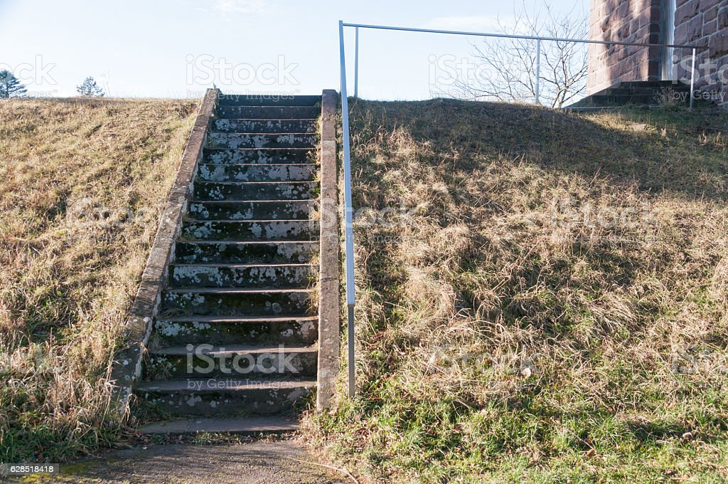 Sand staircase with railing on the slope; stock photo