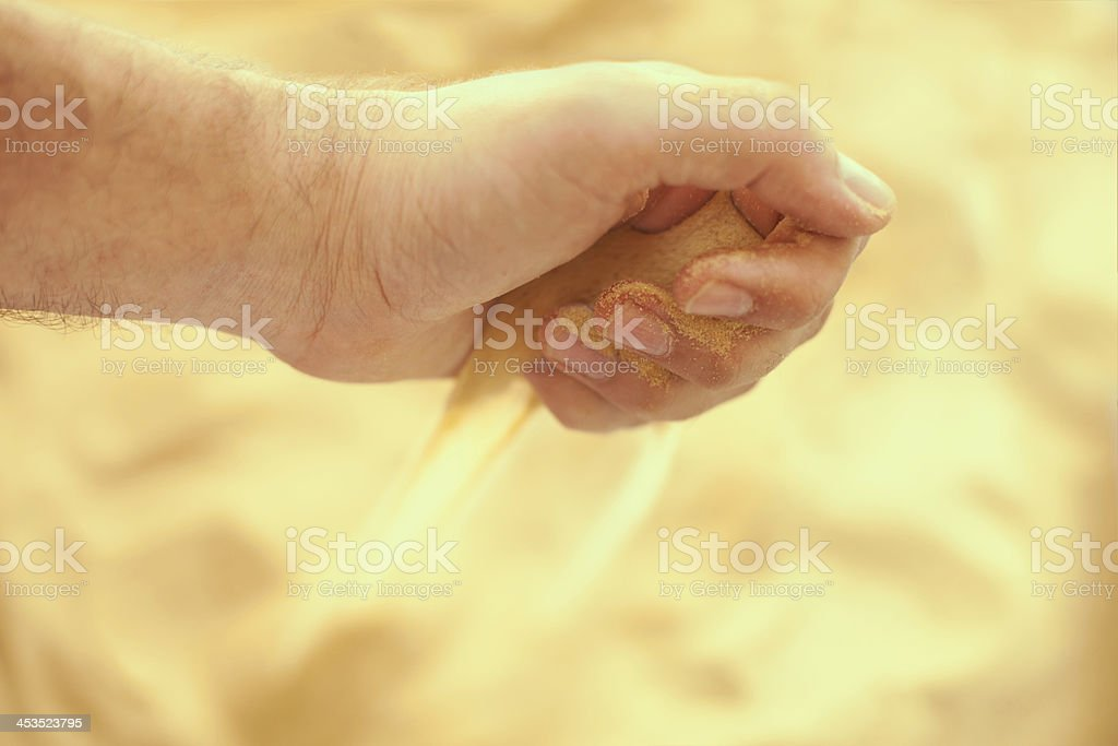 Sand strewing from hand stock photo