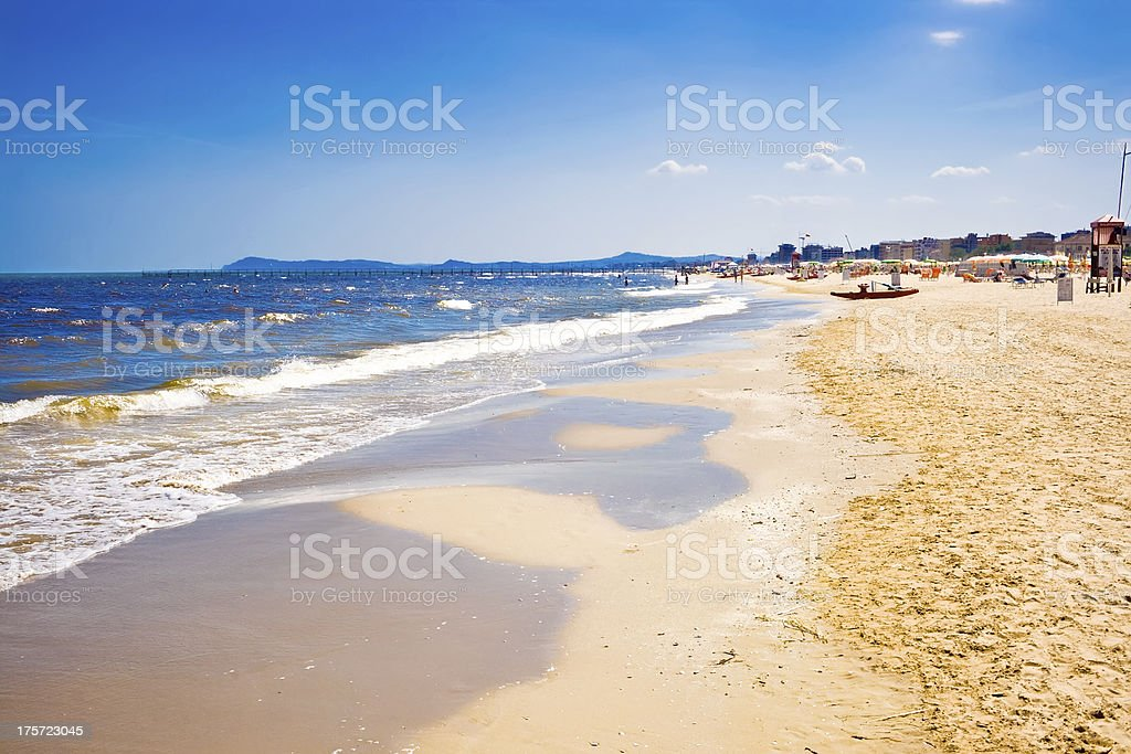 Sand, surf and water on an Italian beach stock photo