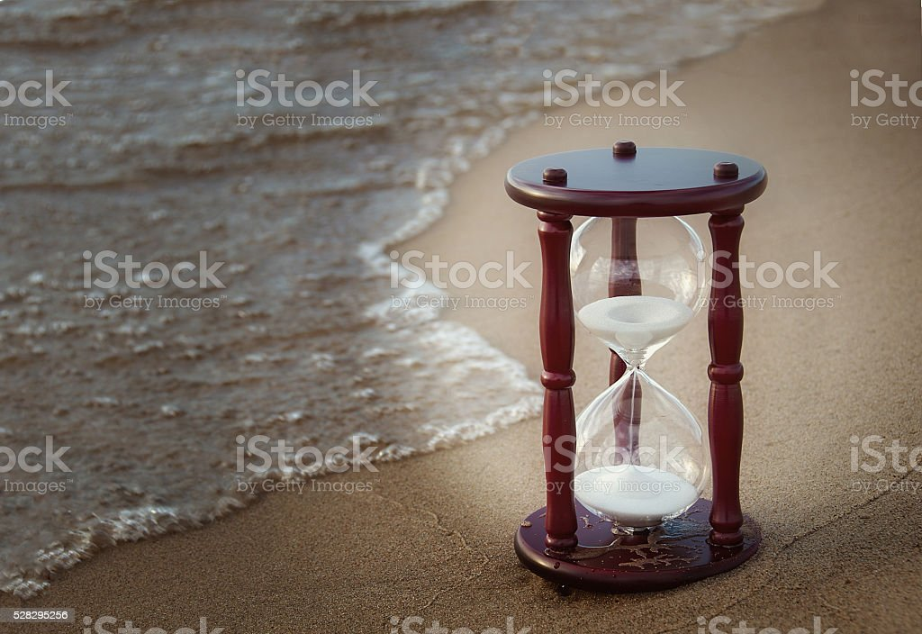 sand timer on beach stock photo