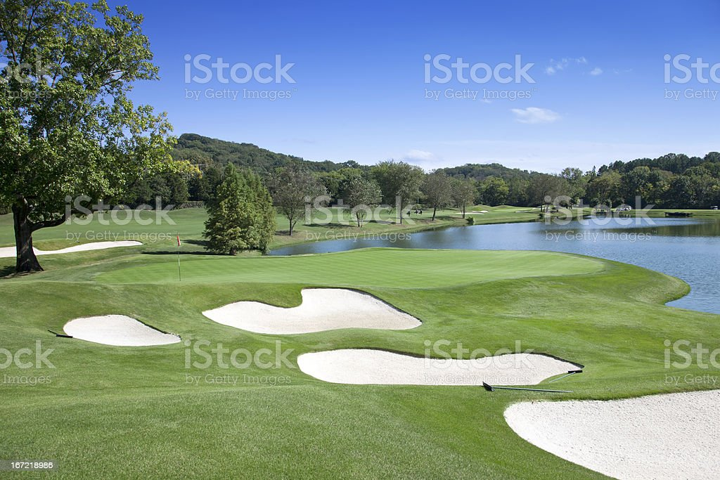 Sand traps and water hazard on pristine golf course stock photo