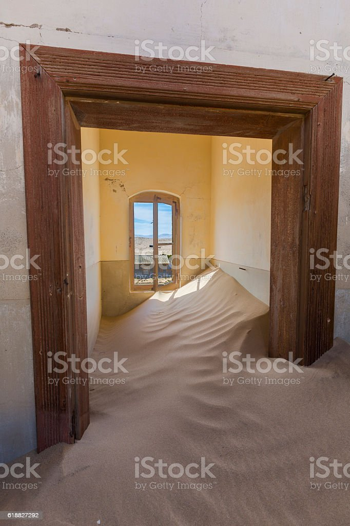 Sand up to the window stock photo