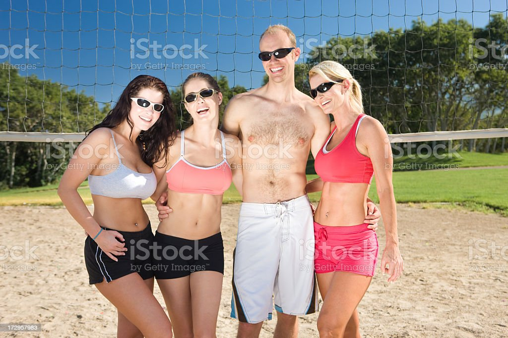 Sand Volleyball-Friends Laughing Together royalty-free stock photo