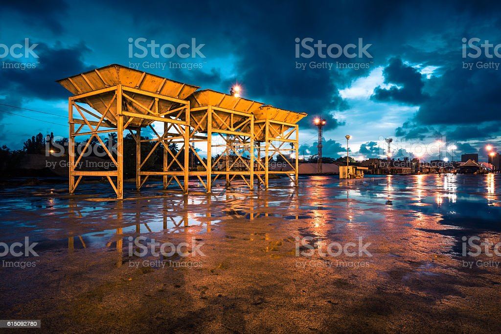 sand yard with some equipments in a cloudy evening stock photo