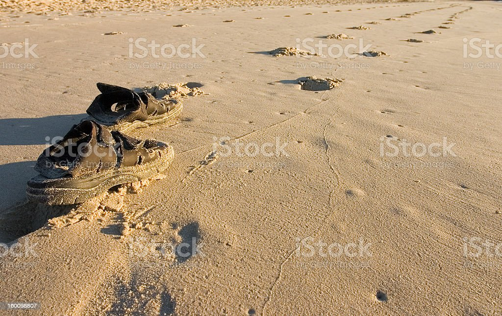 Sandals at the beach royalty-free stock photo