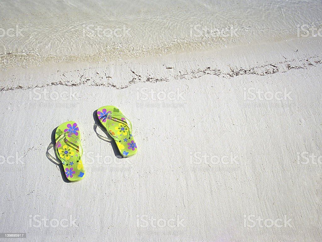 Sandals by the sea royalty-free stock photo