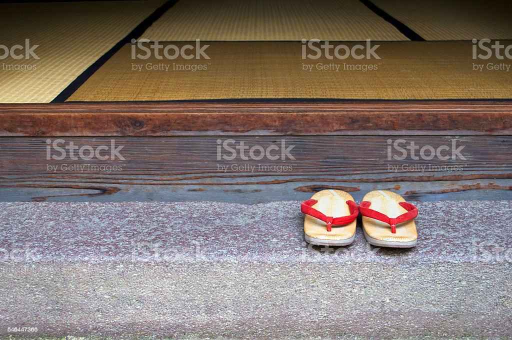 Sandals of red thong on the veranda stock photo