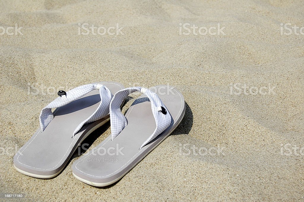 sandals on a beach royalty-free stock photo