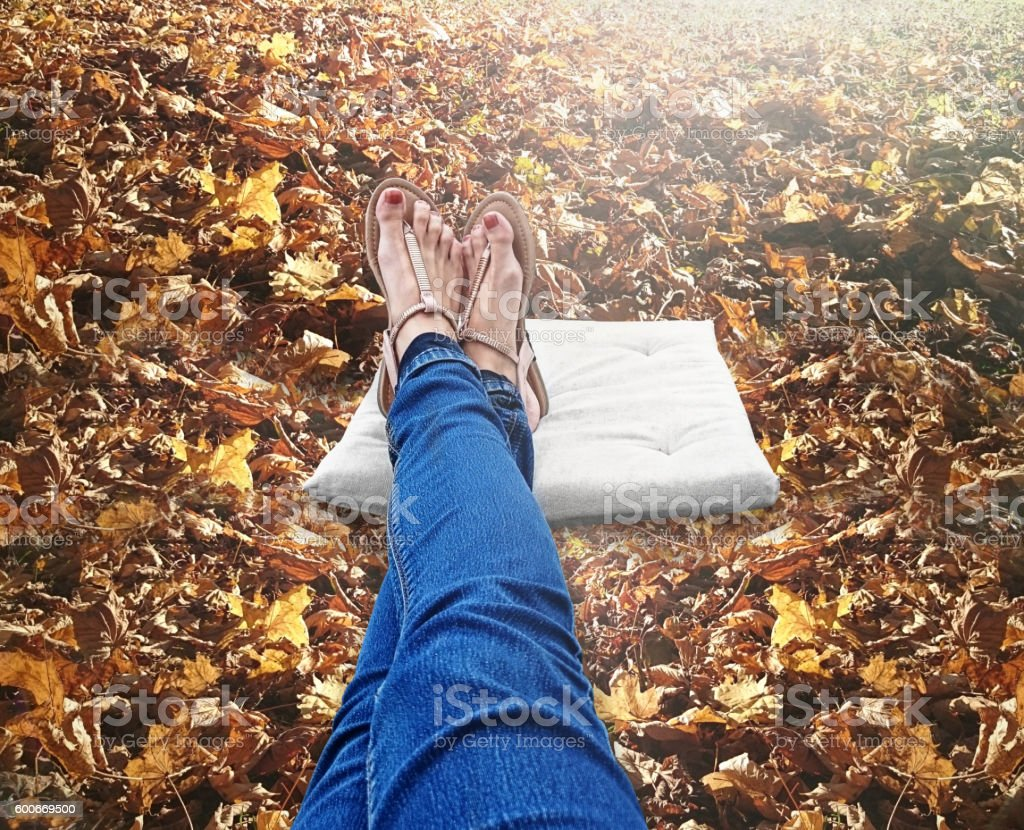 Sandals on autumn leaves background stock photo