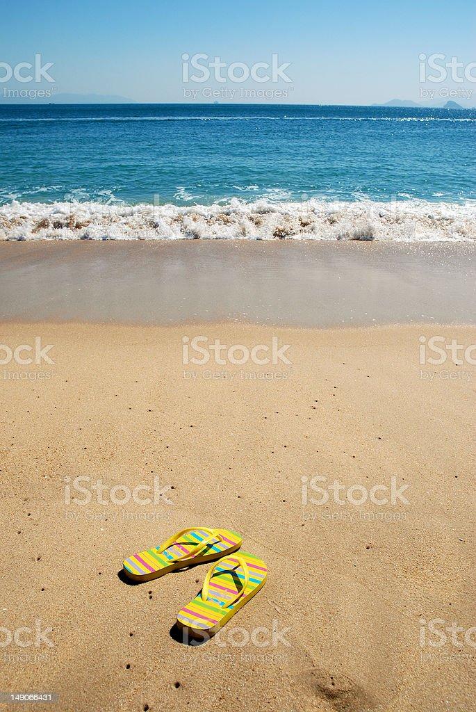 Sandals on beach stock photo