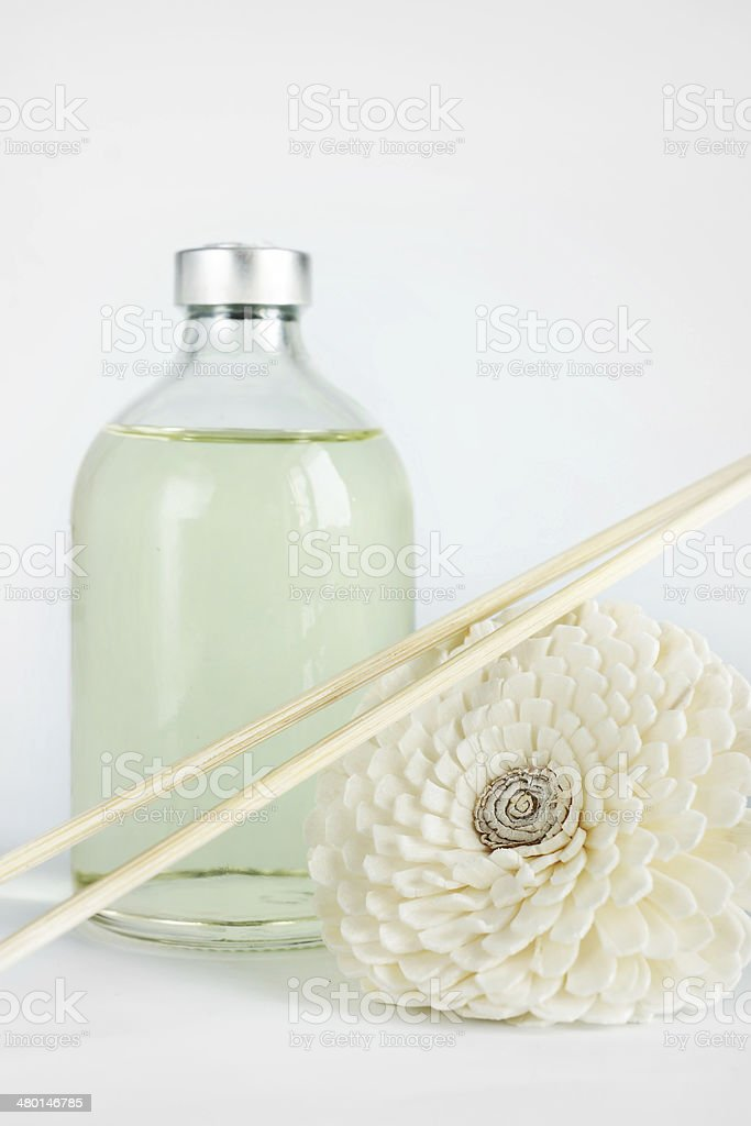 Sandalwood oil in a glass bottle and sticks for spa stock photo