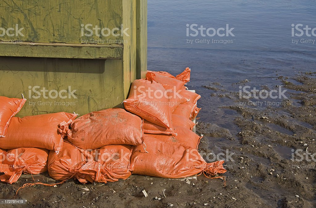 Sandbags hold back rising flood waters royalty-free stock photo