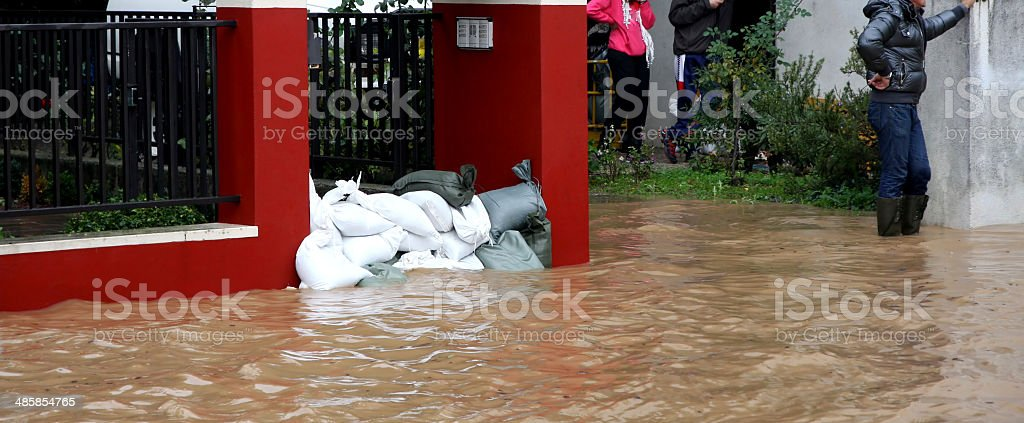 Sandbags in torrential flood defence stock photo