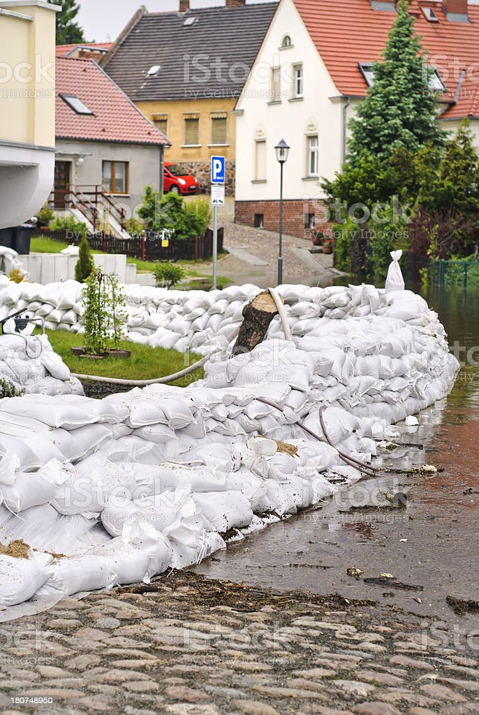 Sandbags to protect a home from flooding royalty-free stock photo