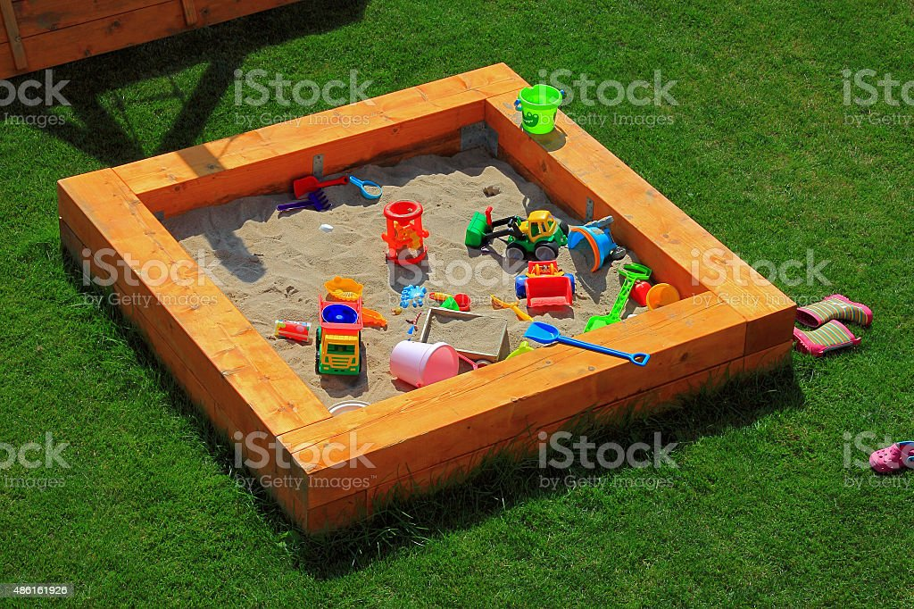 Sandbox playground with lots of toys stock photo