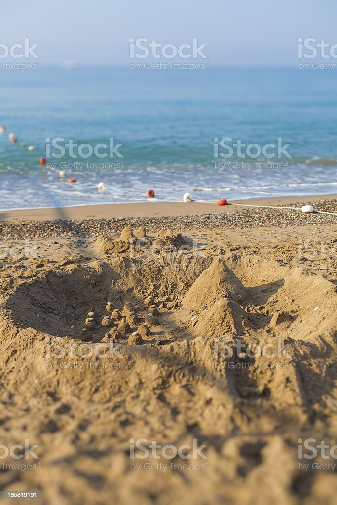 sandcastle and floats stock photo