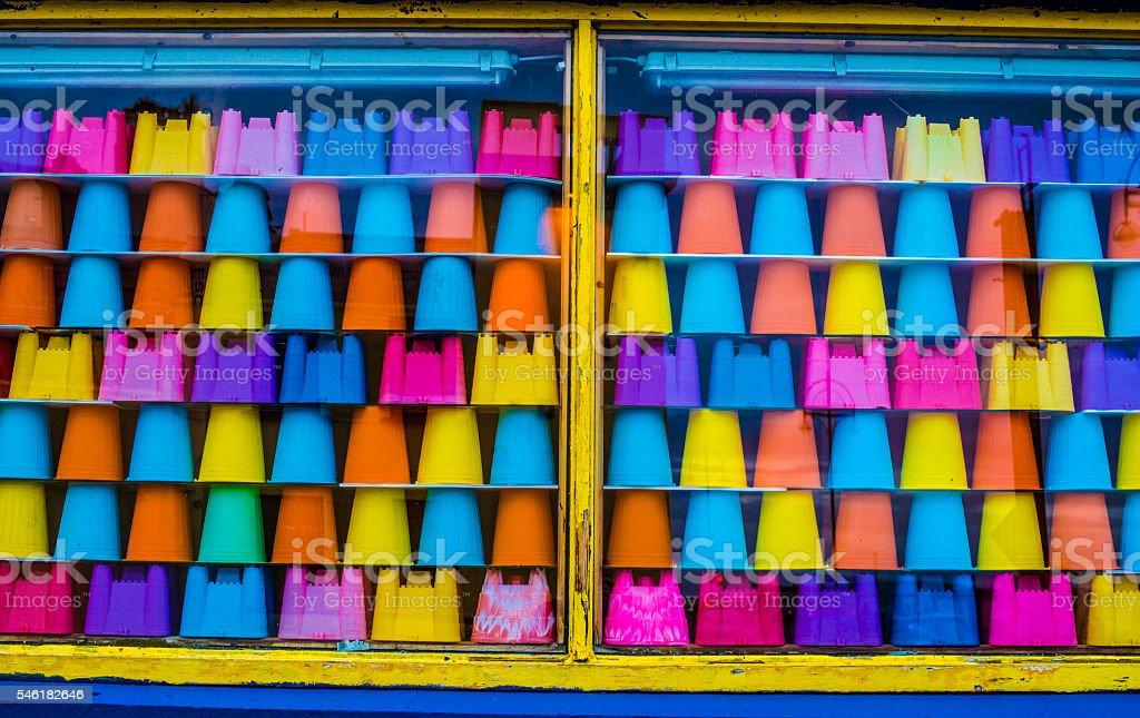 sandcastle buckets on display stock photo