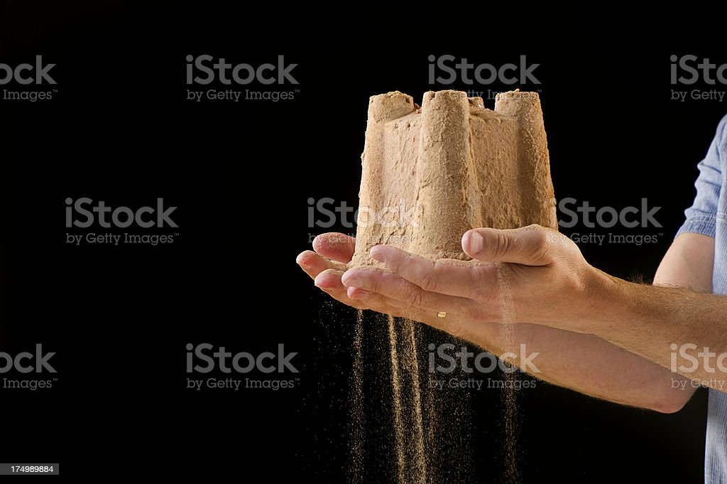 sandcastle in the hand royalty-free stock photo