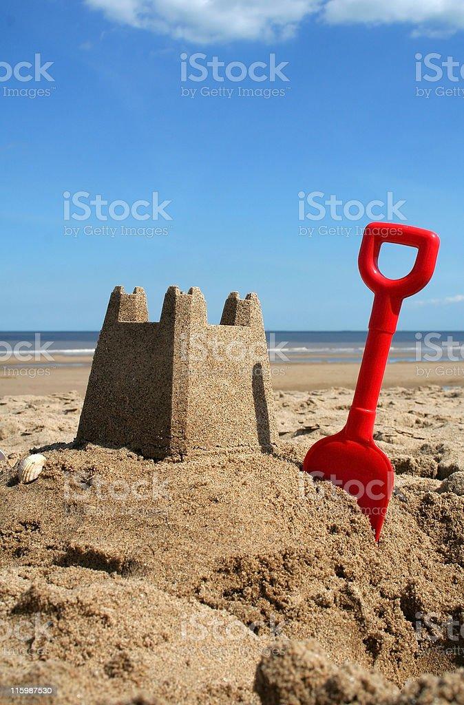 Sandcastle on a sunny beach stock photo