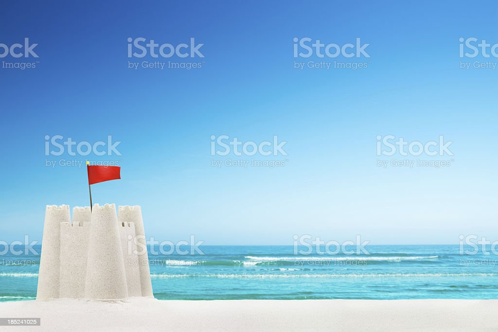 Sandcastle on the beach on a clear sunny day stock photo