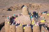 Sandcastle with Easter decoration on Galveston beach