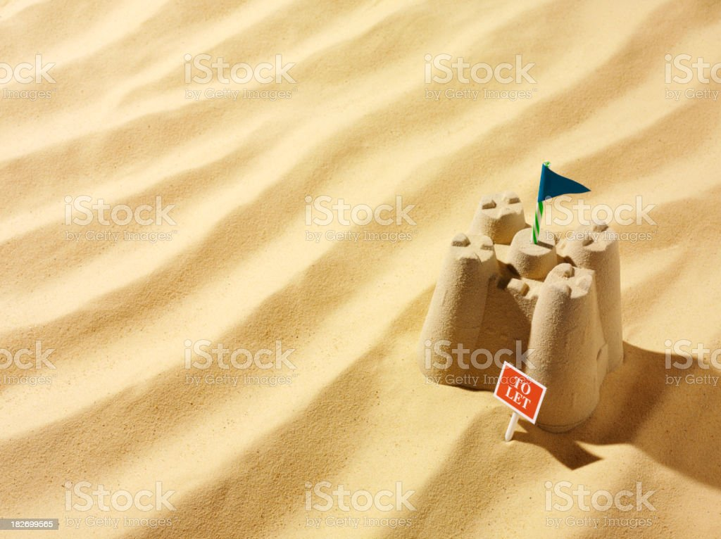 Sandcastle with To Let Sign stock photo