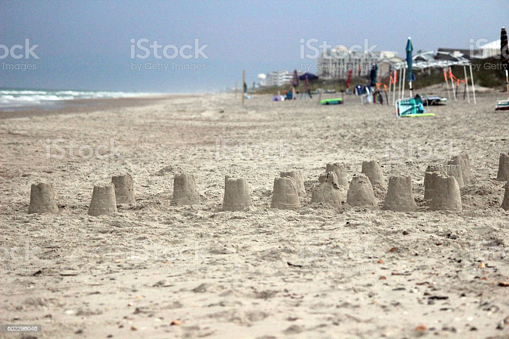 Sandcastles on a Deserted Evening Beach stock photo