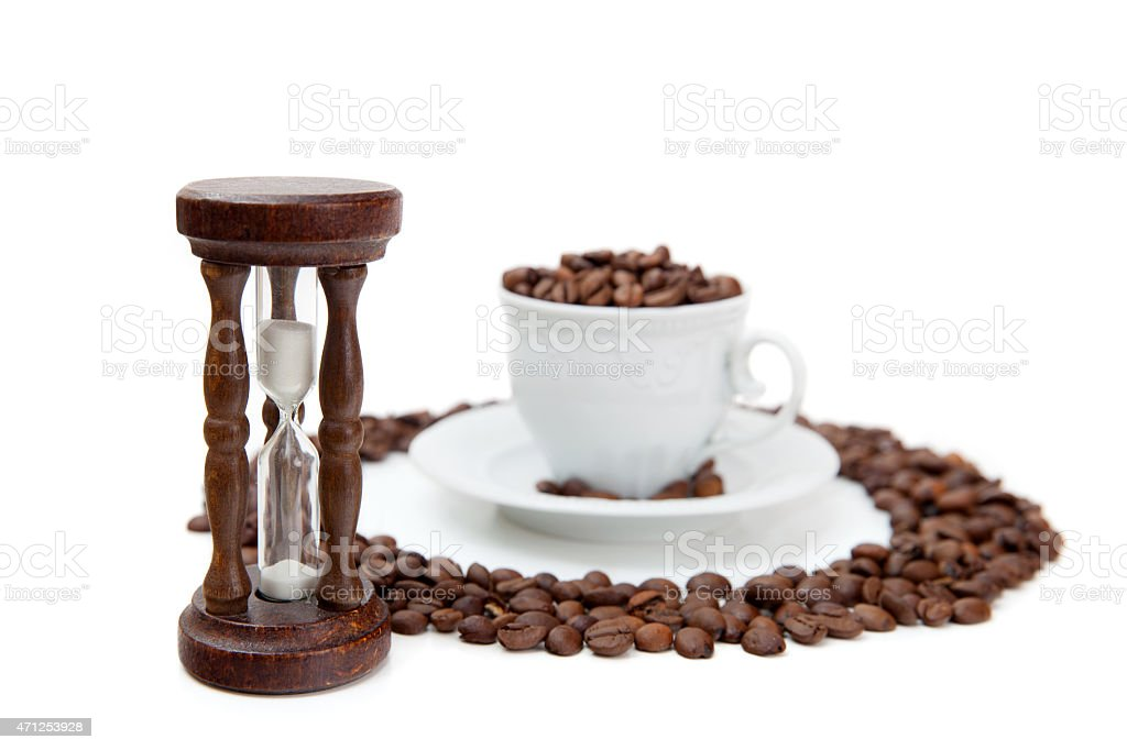 Sandclock and cup of coffee grains stock photo