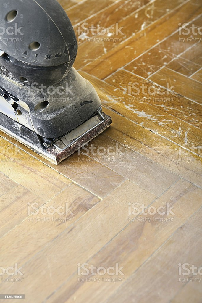 Sander on old parquet stock photo