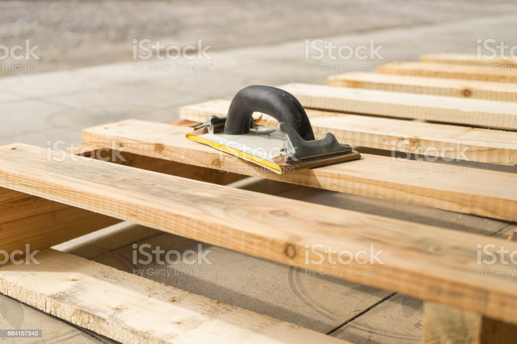 sander tool on wooden background. stock photo