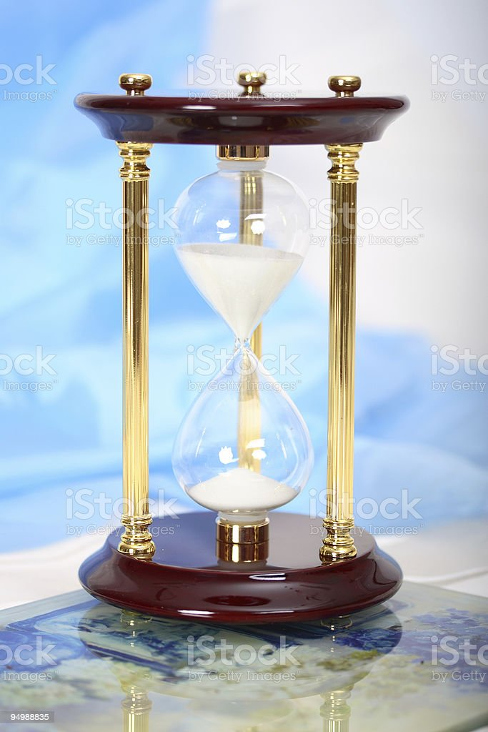 Sandglass on blurred background royalty-free stock photo