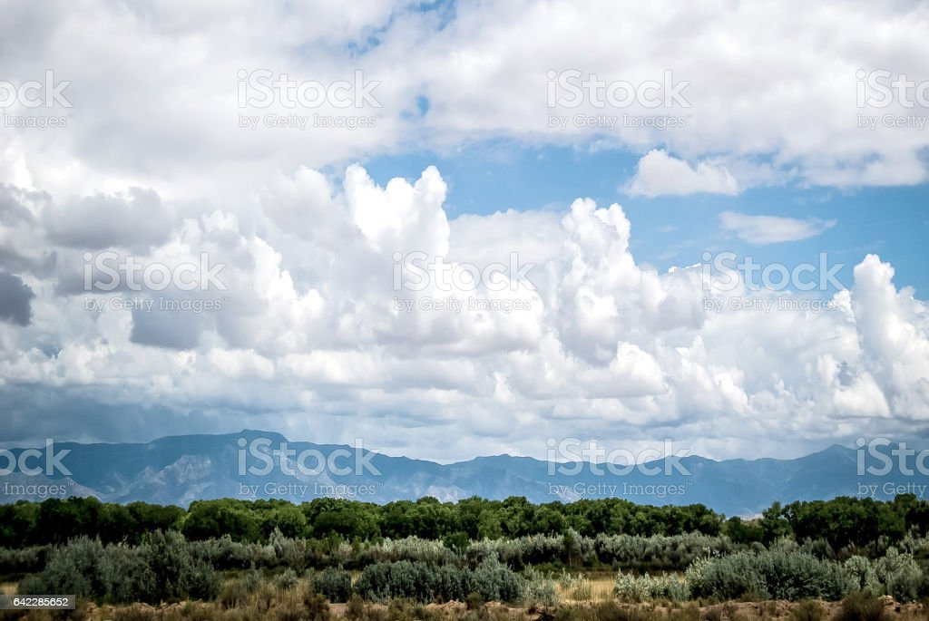 Sandia Mountains with beautiful, dramatic, towering clouds. stock photo