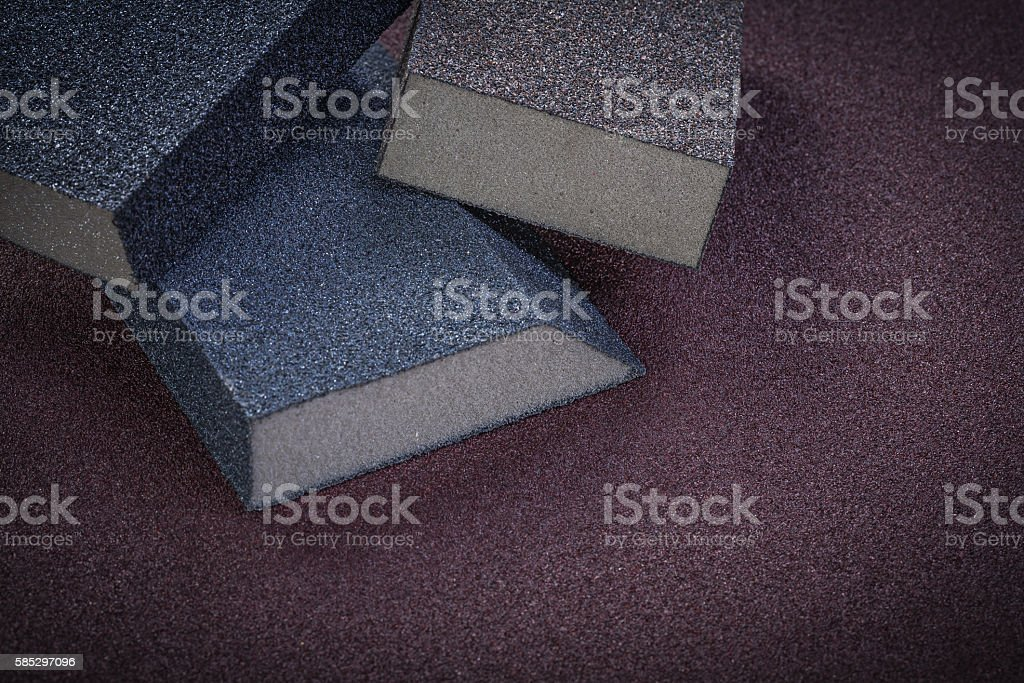 Sanding sponges on emery paper top view abrasive tools stock photo