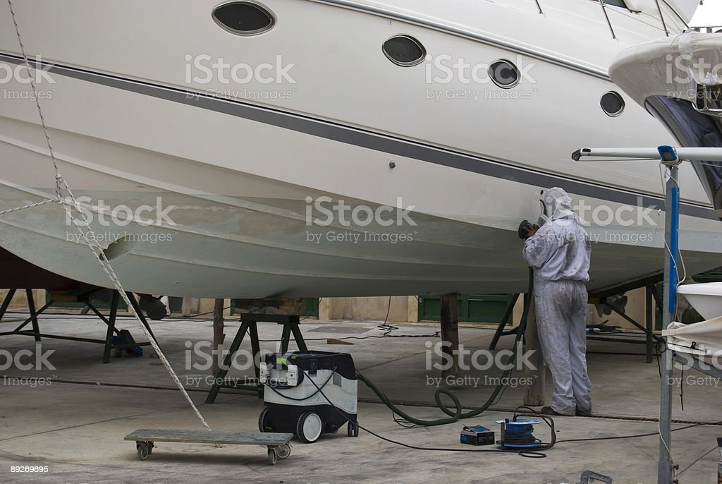 Sanding the bottom of a boat stock photo