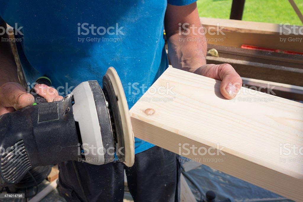 Sanding wooden surface stock photo