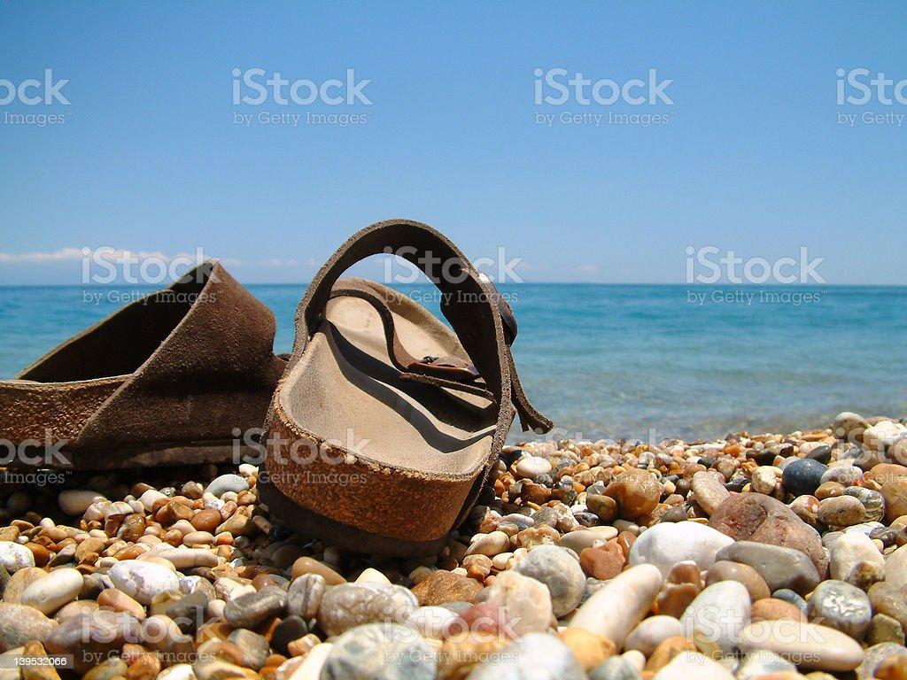 Sandles on the beach royalty-free stock photo